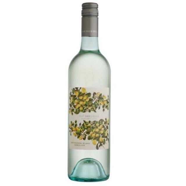 透明の瓶に柑橘の絵が入った白色のラベルの白ワイン
